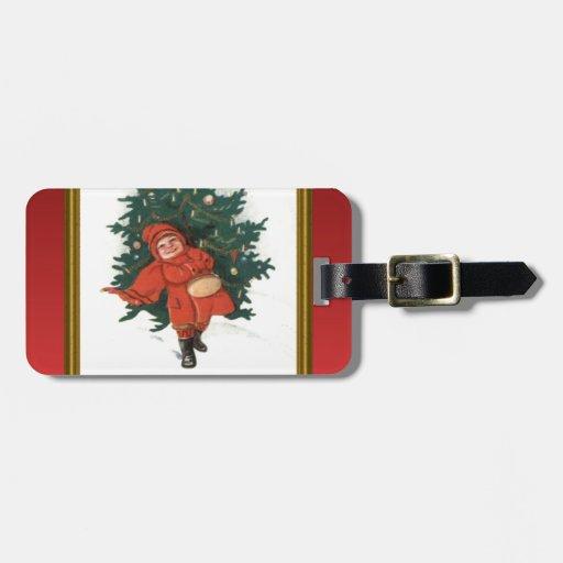 Vintage xmas boy with a Christmas tree Travel Bag Tags