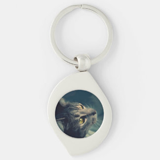 Vintage Yellow-Eyed Cat looking up Above Silver-Colored Swirl Key Ring