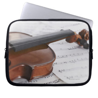 Violin and sheet music laptop sleeve