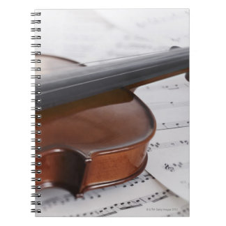Violin and sheet music notebook