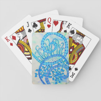 Vivid blue abstract spirals and plants playing cards