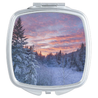 Vivid sunset paints the sky above wintery vanity mirrors