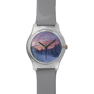 Vivid sunset paints the sky above wintery wrist watches