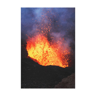 Volcano landscape: hot lava erupting from crater canvas print
