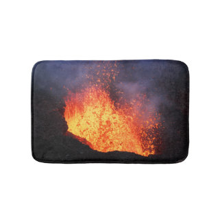 Volcano landscape - hot lava eruption from crater bath mat