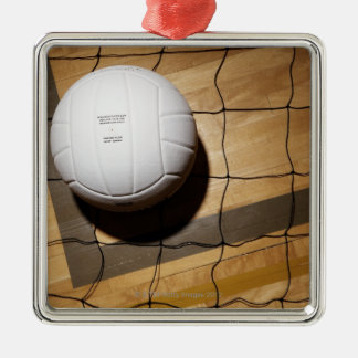 Volleyball and net on hardwood floor of christmas ornament