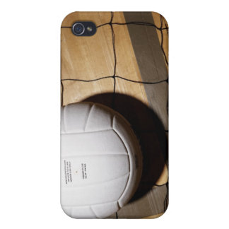 Volleyball and net on hardwood floor of cover for iPhone 4