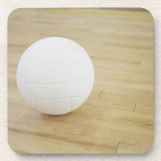 Volleyball on wooden floor coaster