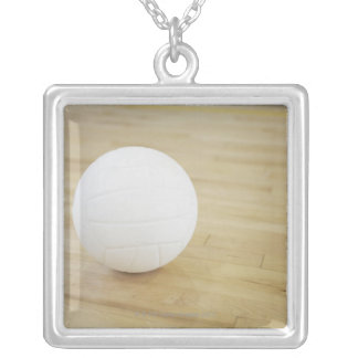 Volleyball on wooden floor silver plated necklace