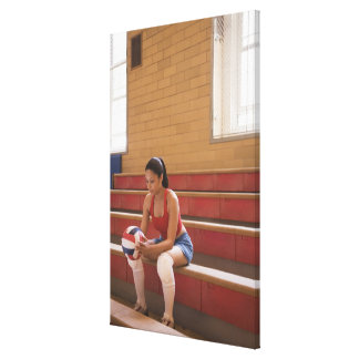 Volleyball player with volleyball canvas print
