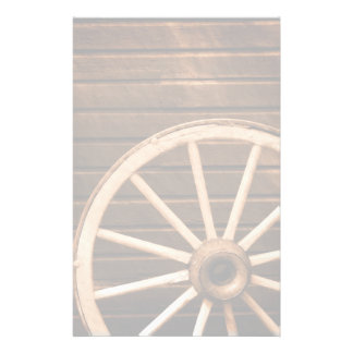 Wagon wheel leaning against old wooden wall custom stationery