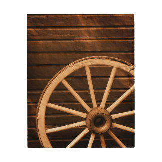 Wagon wheel leaning against old wooden wall wood wall decor