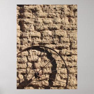Wagonwheel on Brick Wall Poster