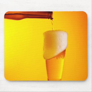 Waiter pouring beer, glass of a cold drink mouse mat
