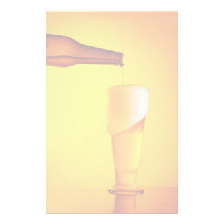 Waiter pouring beer, glass of a cold drink stationery design