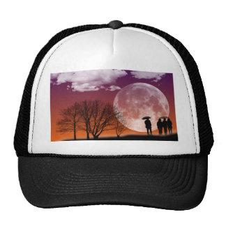 Walking in front of the moon Digital Art Cap