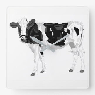 Wall clock with black and white cow graphic design
