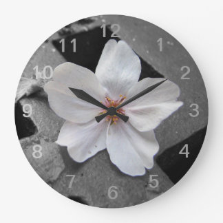 wall clock with cherry blossom.