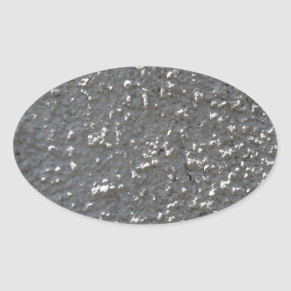 Wall of gray cement with a rough surface oval sticker