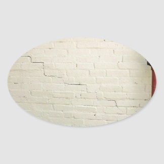Wall of yellow plaster with cracks oval sticker