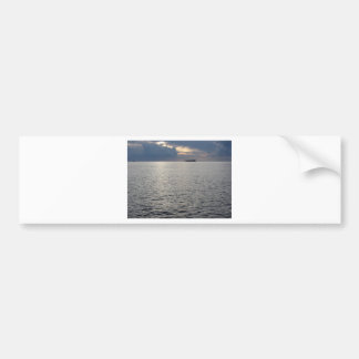 Warm sea sunset with cargo ship at the horizon bumper sticker