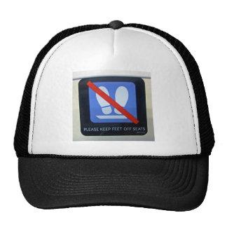 Warning sign inside train mesh hats