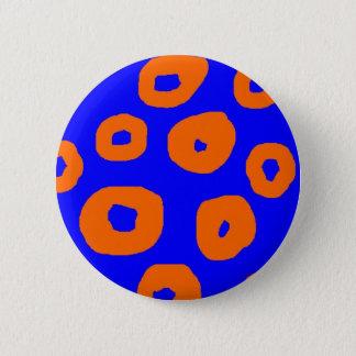 warped orange circles on blue background pins