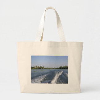 Wash from a boat in a saltwater lagoon canvas bag