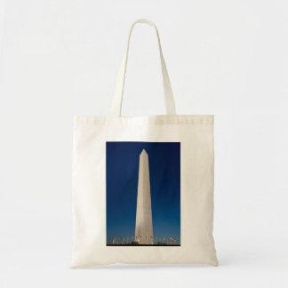 Washington Monument at Dusk Canvas Bags