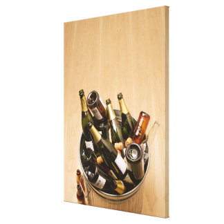 Waste bin full of empty champagne bottles on stretched canvas prints