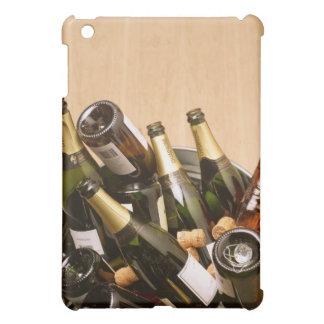Waste bin full of empty champagne bottles on iPad mini cover
