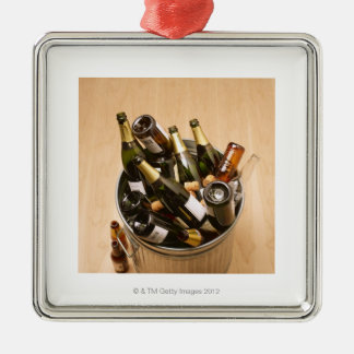 Waste bin full of empty champagne bottles on Silver-Colored square decoration