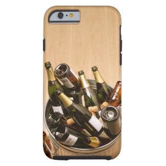 Waste bin full of empty champagne bottles on tough iPhone 6 case