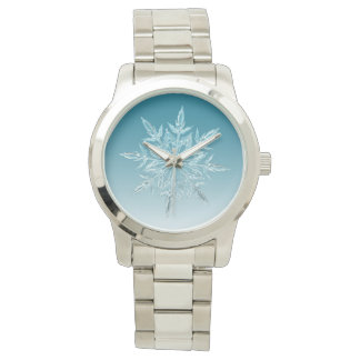 Watch with a snowflake design, blue background.