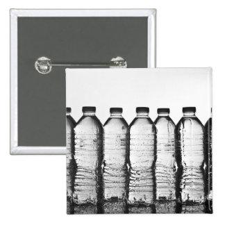 Water bottles in studio 15 cm square badge