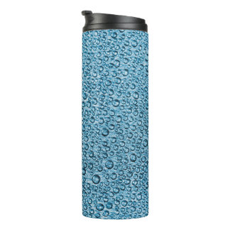 Water Condensation Droplets over Light Blue Thermal Tumbler