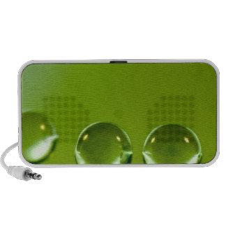 Water droplets on green leaf fresh background speaker system