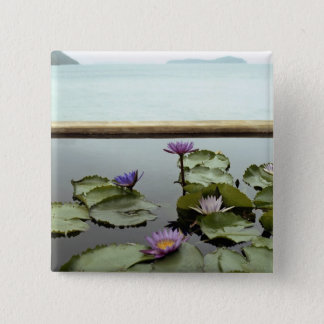 Water lilies in pond by ocean 15 cm square badge