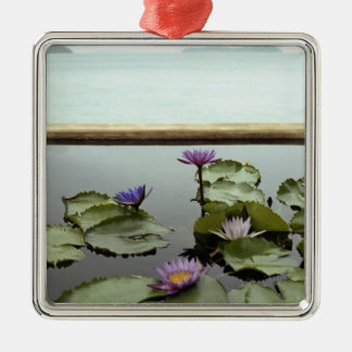 Water lilies in pond by ocean Silver-Colored square decoration