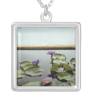 Water lilies in pond by ocean silver plated necklace