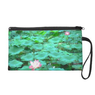 Water lilly clutch wristlets