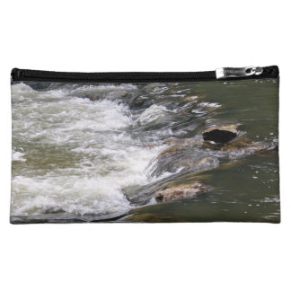 Water of the Guadiaro river between jumping betwee Cosmetic Bags