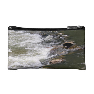 Water of the Guadiaro river between jumping betwee Cosmetics Bags