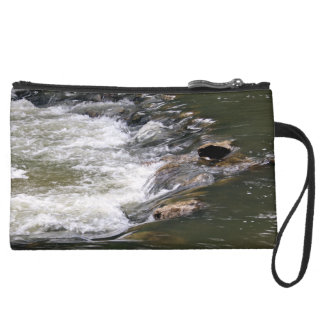 Water of the Guadiaro river between jumping betwee Wristlet Clutches