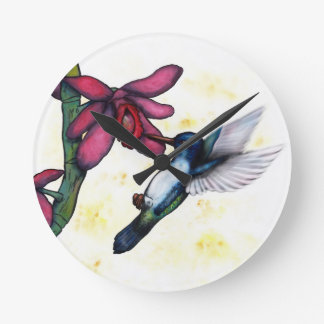 watercolor painting flying hummingbird and orchid round clock