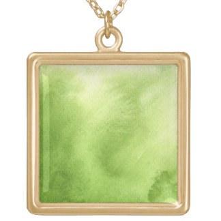 watercolor paints on a rough texture paper gold plated necklace