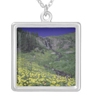 Waterfall and wildflowers in alpine meadow, 3 square pendant necklace