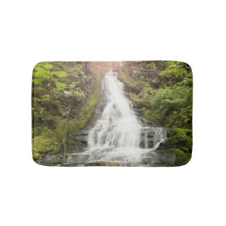 Waterfall in the forest bath mat