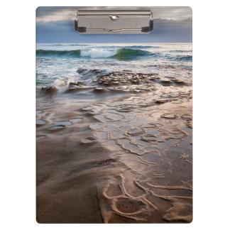 Wave breaking on beach, California Clipboard