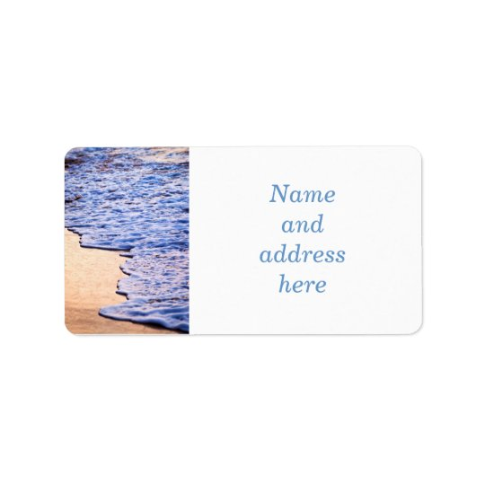 Waves breaking on tropical shore label